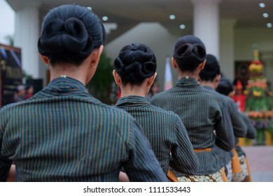 Some women with unique hair do and javanese dress
