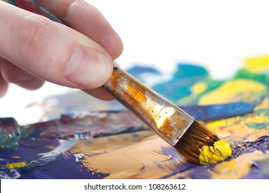 Somebody is painting some picture with paintbrush, isolated on white background