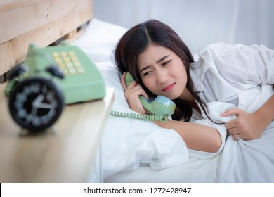 Someone is calling her at night while she were sleeping on bed at bedroom by alone in the house. Attractive beautiful woman gets some bad news. Gorgeous woman gets sad when she got the news