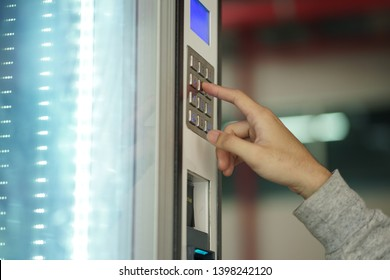 Someone click  botton number on the vending machine
