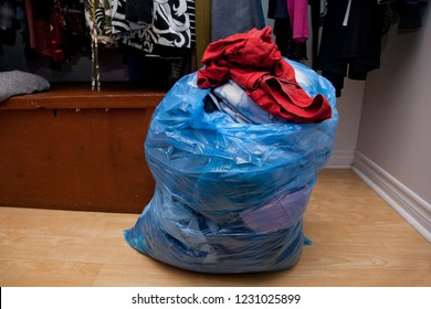 Someone has cleaned out their closet and made a bag of clothes to donate or purge