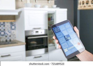 someone operates with a smart kitchen app on a tablet in kitchen environment