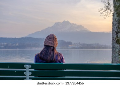 Someone sitting for looking on the mountain and lake view in Lucerne town Switzerland.