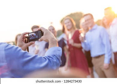 Someone taking a photo of a group of people at a party