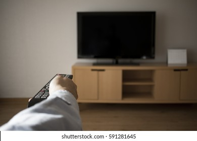 someone is using the remote controller to the television