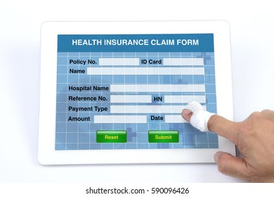 Someone using tablet to complete health insurance claim form on white background.
