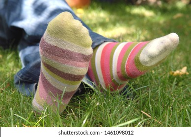 Someone wearing colorful socks on the grass