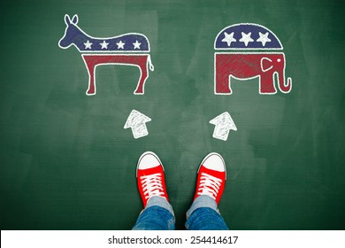 Someone wearing red sneakers choosing between democrats and republicans