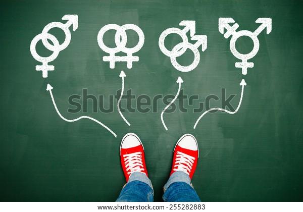 Someone wearing red sneakers choosing between genders