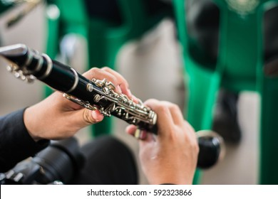 someone who playing music,clarinet,close up