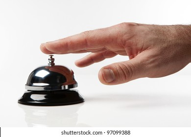 someone's hand pressing a service bell what could they want