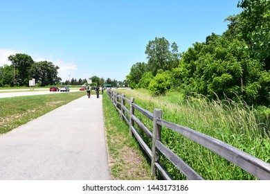 Somers, Wisconsin / USA - June 29, 2019: A group of bicyclists enjoy a ride on an early summer day on the paved bike path running along side Highway 31.