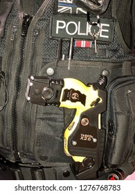 Somerset, UK - 18th January 2018: A British Police officer with a Taser gun, conceptual image