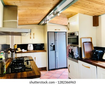 Somerset , UK - 1st April 2018: Traditional Kitchen with modern utensils and appliances. Concept of modern living.
