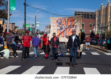 Somerville, Massachusetts, USA - OCTOBER 11, 2015 - Second day of HONK Festival of activist street bands. Brass Bands in outlandish costumes proceedng to Davis square playing and dancing