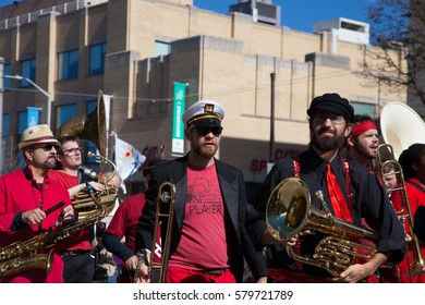 Somerville, Massachusetts, USA - OCTOBER 11, 2015 - Second day of HONK Festival of activist street bands. Brass Bands in outlandish costumes proceeding to Davis square playing and dancing