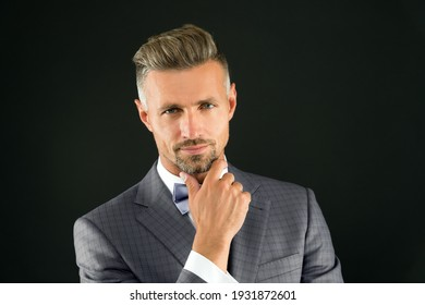 Something on his mind. Gentleman hipster hairstyle. Barber shop concept. Beard and mustache. Guy well groomed handsome macho wedding tuxedo. Hipster groom. Cunning glance. Attractive mature hipster.