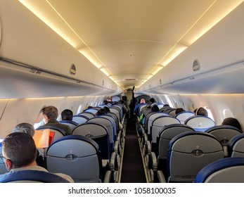 Somewhere over Texas / USA - March 30, 2018: Passengers ride on Embraer ERJ-190 (twin-jet) on Aeromexico flight between Monterrey, Nuevo Leon, Mexico and Detroit, Michigan.