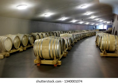 SOMLO, HUNGARY - AUGUST 16, 2018: Wooden barrels with wine in a Kreinbacher Birtok Champagne Factory.