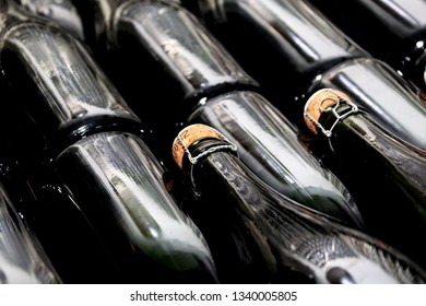 SOMLO, HUNGARY - AUGUST 16, 2018: Champagne production in traditional way in a wine cellar Kreinbacher Birtok winery in the Somlo. champagne bottles with cork
