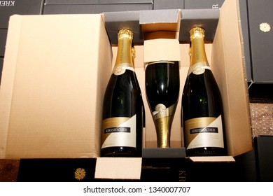 SOMLO, HUNGARY - AUGUST 16, 2018: Kreinbacher Birtok winery in the Somlo. Kreinbacher champagne bottles in a cardboard box