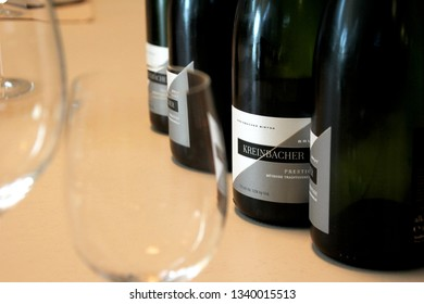 SOMLO, HUNGARY - AUGUST 16, 2018: Kreinbacher Birtok winery in the Somlo. Close-up of Kreinbacher champagne bottles and glasses