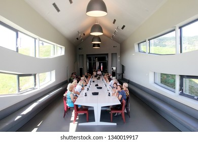 SOMLO, HUNGARY - AUGUST 16, 2018: Kreinbacher Birtok winery in the Somlo. Kreinbacher champagne tasting in a restaurant. People are sitting at the table