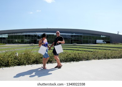 SOMLO, HUNGARY - AUGUST 16, 2018: Kreinbacher Birtok winery in the Somlo. Man and woman at winery with white Kreinbacher shopping bags in hands