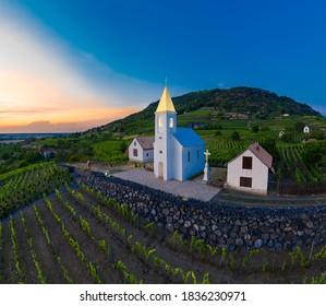 Somlo Hungary vineyard in wine region. Panorama photo of church Szent Ilona.