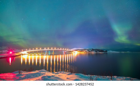 Sommaroy Bridge is a cantilever bridge connecting the islands of Kvaloya and Sommaroy with Aurora Borealis - Hillesoy Tromso Norway