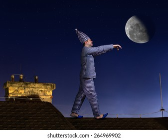 Somnambulist sleepwalker in pajamas and a night cap with hands forward walking on the roof on a background of the night sky with the moon.