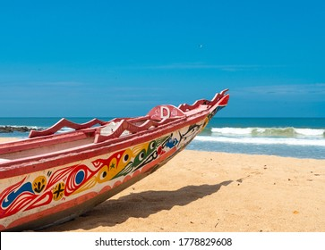 Somone, Senegal, July 18, 2020: Colorful fisher boat on the beach, Somone, Senegal