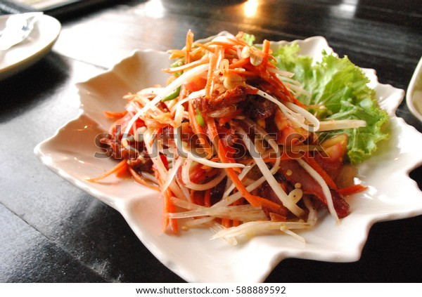 Somtam food from Thailand is spicy food with papaya and shrimp nut tomato and vegetable in the dish  with sticky rice  for Thai people