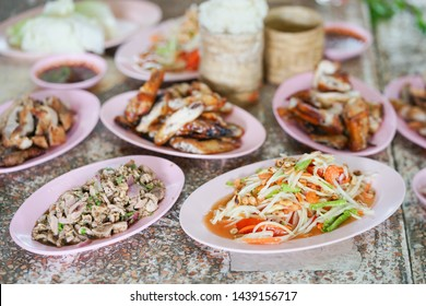 Somtum. Also called Somtam, is Thai green papaya salad. Sometimes it is added with various topping such as salted crab or salted eggs. This is original called Tum-Thai. Native to north eastern food.
