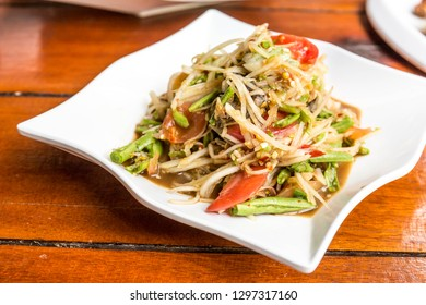 Somtum or Papaya salad native food in the northeast of Thailand. Somtum Thai has sweet and sour taste. Isan Food.