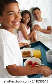 Son Bringing Parents Breakfast In Bed