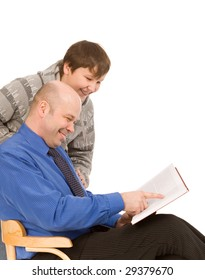 son and father with book on a white background