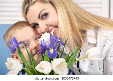 Son gives his beloved mother a beautiful bouquet of tulips.The concept of the celebration,women's day.