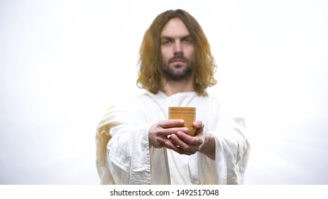 Son of God holding wine, sacramental Eucharist in Catholic church, Communion