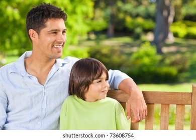 Son with his father on the bench