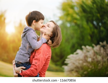 Son is kissing his mother