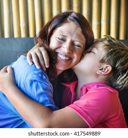 Son Kissing Mother Hugging Family Concept