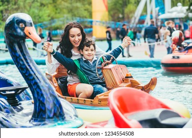 Son and mother in the amusement park.