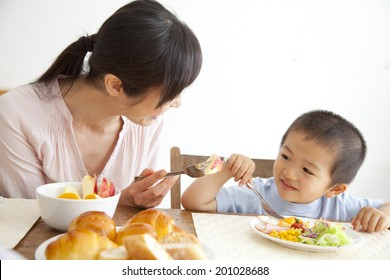 Son and mother having breakfast