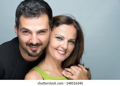 Son and mother smiling