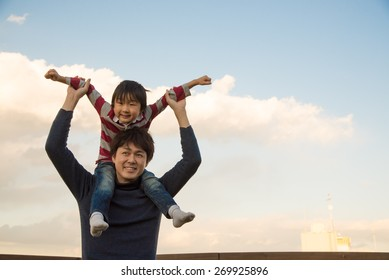Son on fathers shoulders in Tokyo