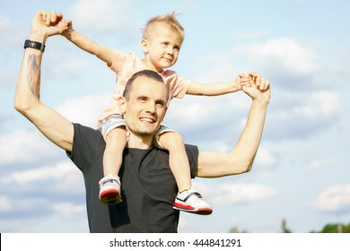 son on the shoulders of his father