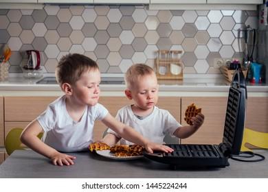 son preparing waffles in kitchen Belgian waffles waffle iron