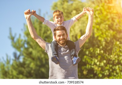 The son sit on the neck of father