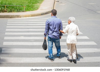 son who helps his mother crosses the street